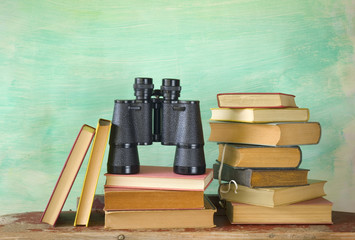 books with binoculars, search, research, education concept, free