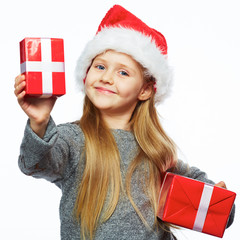 Smiling girl hold christmas gifts.  Isolated portrait