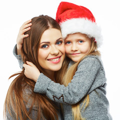 Mother with daughter christmass portrait. Happy family.