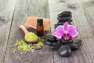 Moth orchid, bath salt and black stones close-up