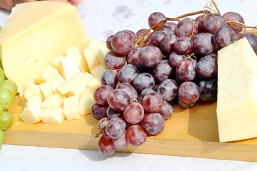 Asiago cheese and black grapes and white grape