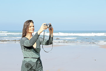 Beautiful woman makes beautiful pictures at the beach in Portuga