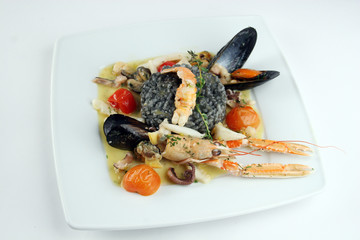 Risotto with cuttlefish ink and seafoods