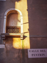 window with a sun beam in venice, italy