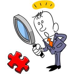 ジグゾーパズルのピースを発見するビジネスマン