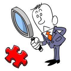 ジグソーパズルのピースを検証するビジネスマン