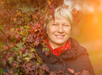 Portrait of a beautiful middle-aged woman outdoors.