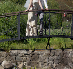 Handsome groom and bride on bridge