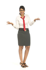 Cheerful attractive Indian businesswoman on white background.