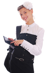 Beautiful Girl in school uniform indicates on the tablet