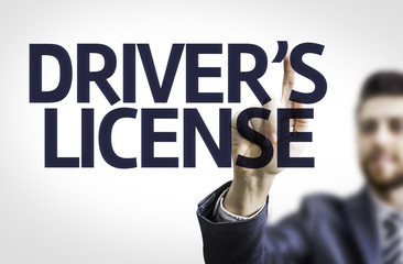 Business man pointing the text: Drivers License
