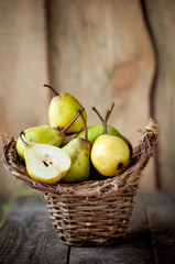 fresh pears in a wicker basket
