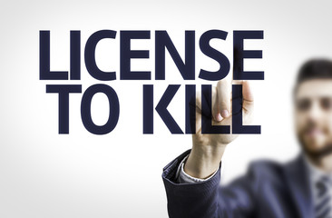 Business man pointing the text: License to Kill