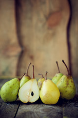 fresh pears lie on a wooden table