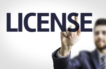 Business man pointing the text: License
