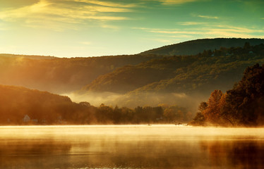 Beautiful autumn landscape, the lake in the morning fog