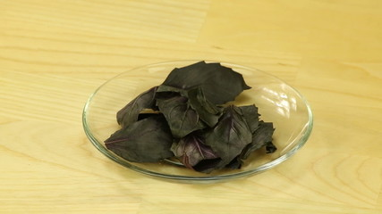 Red basil leaves in a glass plate