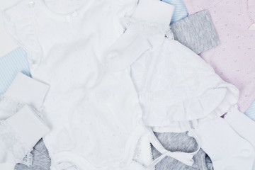 Overhead view of baby clothes, studio shot