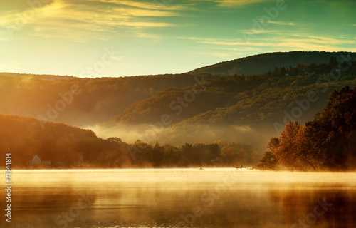 Beautiful autumn landscape, the lake in the morning fog - 71944814