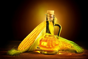 Bottle with oil and a corncob