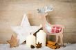 canvas print picture - weihnachtsdeko aus holz im schnee