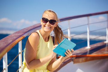 Happy woman with pad during sea traveling