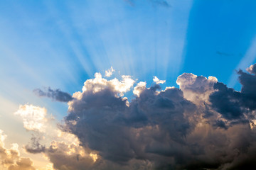 Clouds In The Blue Sky and Sun Rays