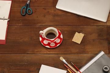 Coffee break on wooden desk, top view