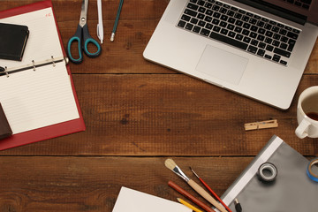 Office work place supplies on wooden desk - top view