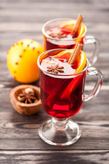 Two glasses of mulled wine with spices and orange