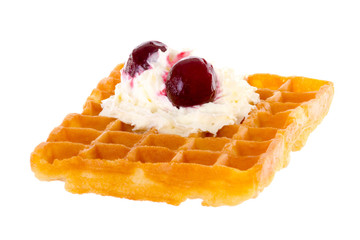 Brussels waffle with cream and cherries brightened