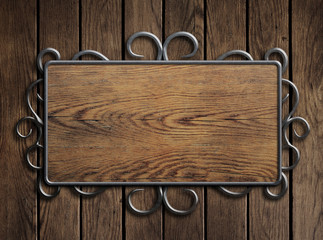 Old wood plate or sign in metal frame on vintage door