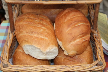 A Wicker Basket of Freshly Baked Bread Loaves.