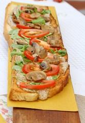 Italian bruschetta topped Arugula and tomato mushrooms