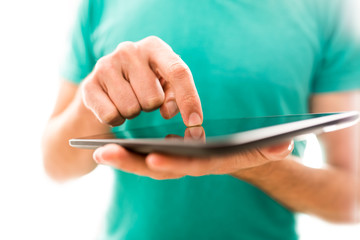 Young person navigating a tablet