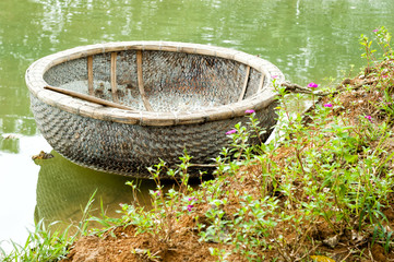 Vietnamese round boat in green water