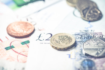 pound sterling coins over notes