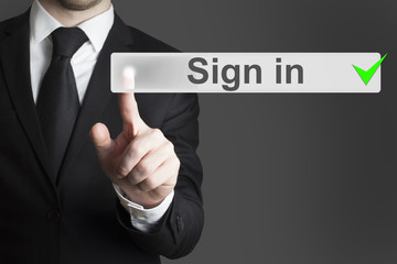 businessman pushing button sign in