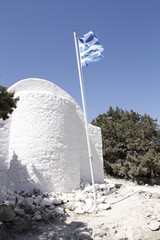 church with greek flag in monolithos castle