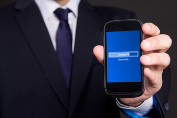 mobile phone loading in business man hand