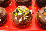 Halloween Cupcakes with Sprinkles in a Red Container
