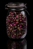 Jar full of aromatic dried fruits poster