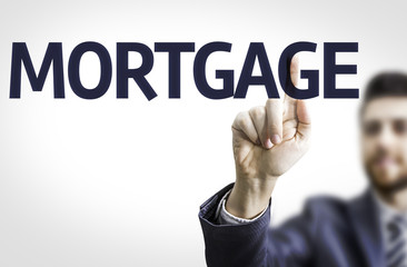 Business man pointing the text: Mortgage