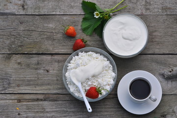 Healthy breakfast with cottage cheese and sour cream