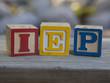 Indivualized Education Plan (IEP) alphabet blocks - 71954608