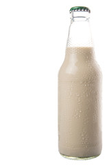 A bottle of soybean milk over white background