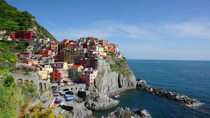Picturesque view of Manarola, Italy in the sunny summer day