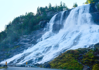 Summer waterfall on mountain slope (Norway).