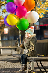 child with air-balloons