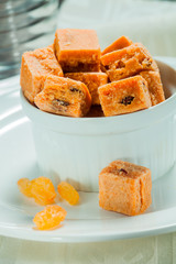 a bowl with milk caramel candies with raisins